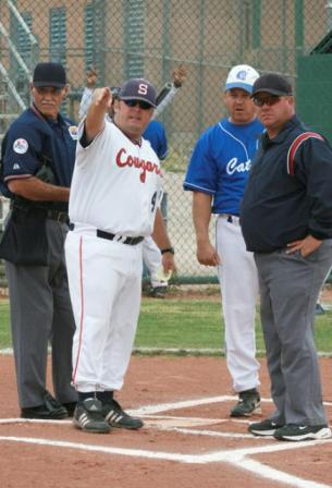 While coaches and umpires talk at home plate, players can use that time to focus in on the game