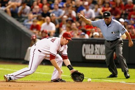 Feet a little wider than shoulders,knees bent, your knees take your glove to the ground.  Field ball out in front.