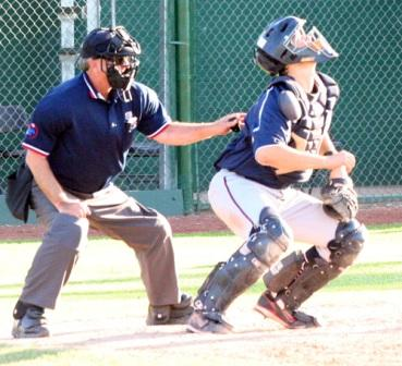 ready to provide the catcher with room to field the pop up