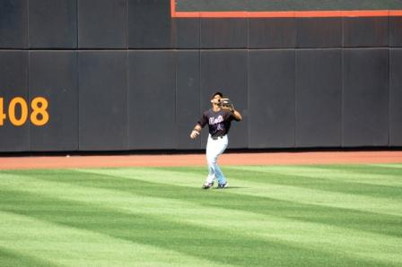 outfielder setting up on fly ball