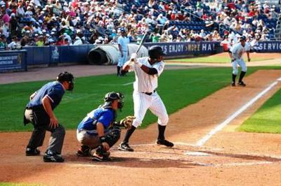Batter is entitled to the batter's box, catcher must work around him, if he stays stationary.