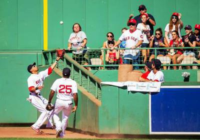 Home run or out, if the player catches the ball and falls into the stands?