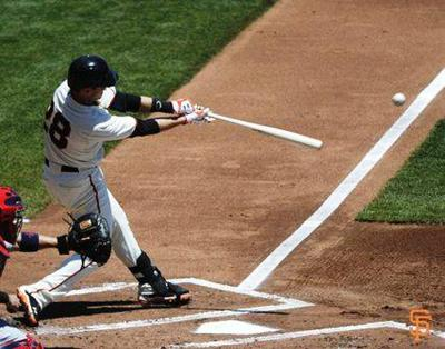 After contact, top hand starts to rotate as hitter follows through