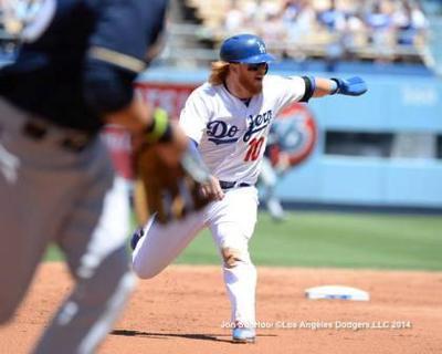 Runner must avoid fielder attempting to field ball in base path.