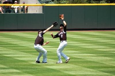 Left fielder, shortstop converging on pop fly