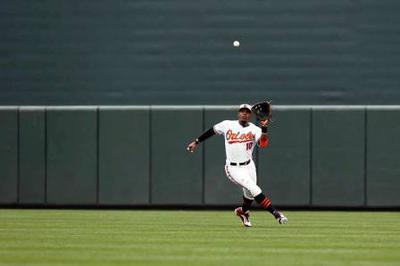 Outfielder Getting Around, To and Through A Fly Ball